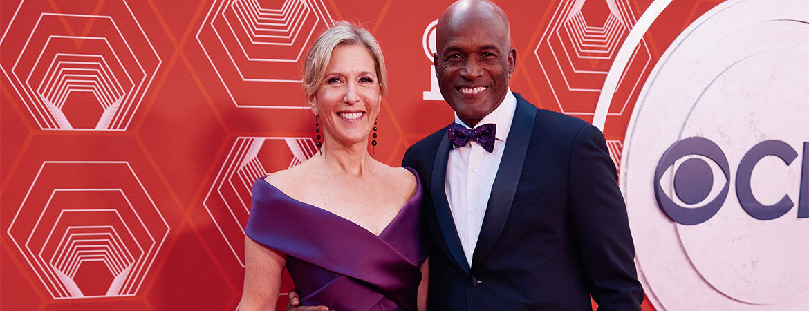 Photo of Lauren Reid (President of the John Gore Organization) and Director Kenny Leon on the red carpet of the 74th Annual Tony Awards